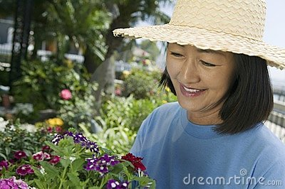 Woman in straw hat gardening