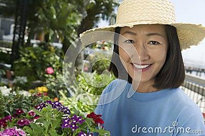 Woman in straw hat gardening