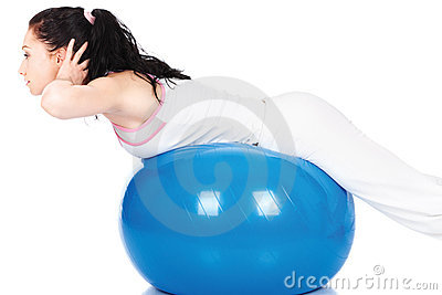 Woman streching on the blue ball