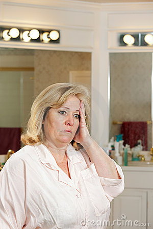 Woman stressed bathroom