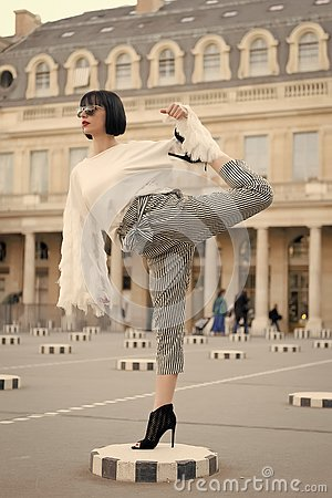 Free Woman Stretch Leg On Square In Paris, France Royalty Free Stock Photography - 133966287