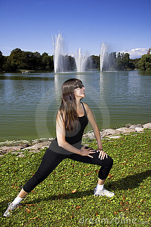 Free Woman Stretching By The Lake Stock Images - 10652424