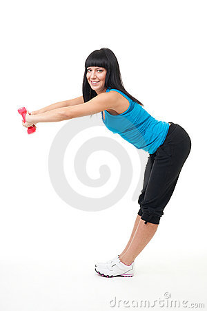 Woman stretching with dumbbells
