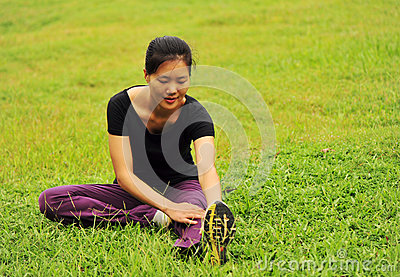 Woman stretching on grass