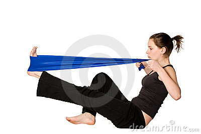 Woman is stretching her leg with a Resistance Band