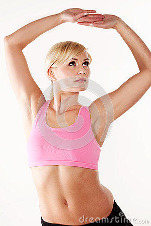Woman stretching her muscles while exercising