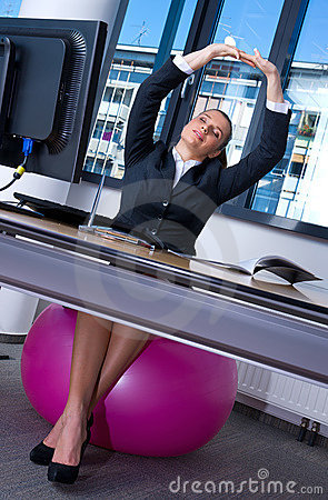 Free Woman Stretching In Office Stock Images - 20948554