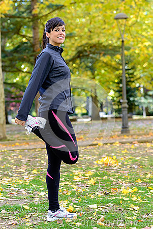 Woman stretching legs and warming up