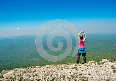 Woman stretching in mountains