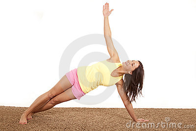 Woman stretching on one arm