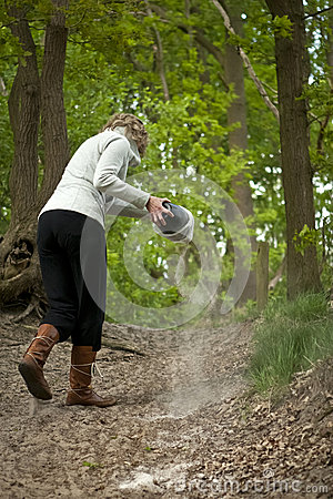 Free Woman Strewing Ashes Stock Images - 28843264