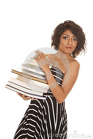 Woman striped dress stack of books looking serious