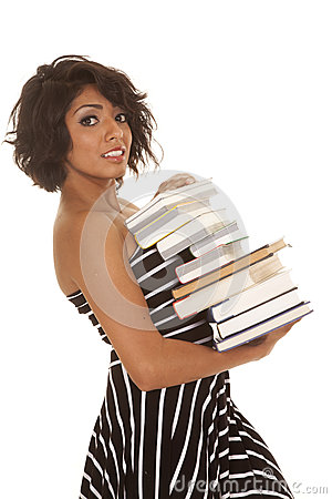 Woman striped dress stack of books serious side