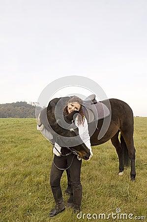 Woman stroking horse.