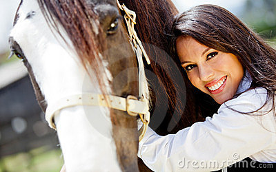 Woman stroking a horse