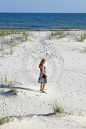 Woman Strolling on the Beach