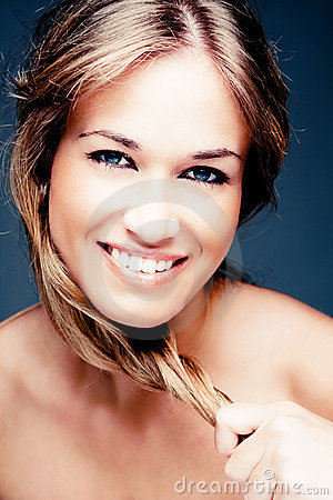 Woman with strong blond hair and beautiful smile
