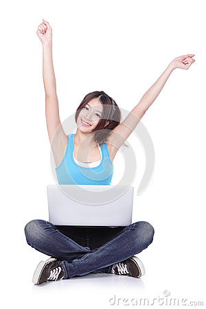 Woman student happy sitting with computer