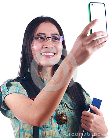 Woman student taking picture with her handphone