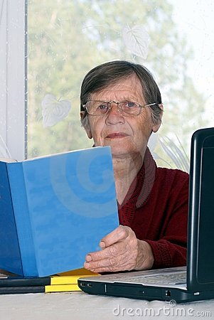 The woman studies the computer