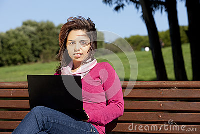 Woman studying with a laptop