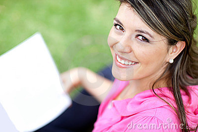 Woman studying at the park