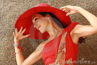 Woman with stunning big red hat