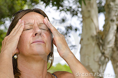 Woman suffering painful headaches