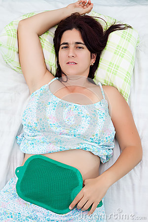 Woman suffering from uterine or abdominal pain