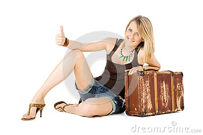 Woman suitcase hitchhiking
