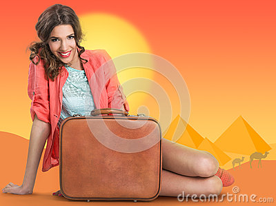 Woman with suitcase over a background drawing of pyramids