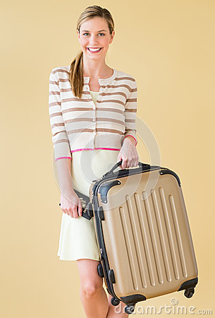 Woman With Suitcase And Passport Standing Against Colored Backgr