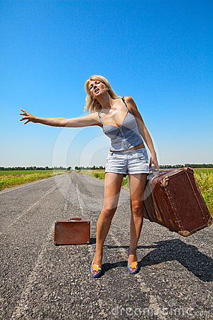 Woman with suitcase stops the car