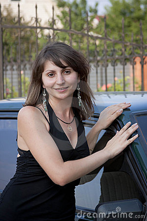 Woman in summer is about the car