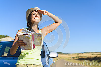 Woman on summer car travel vacation