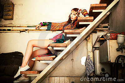 woman in summer dress sit on stairs