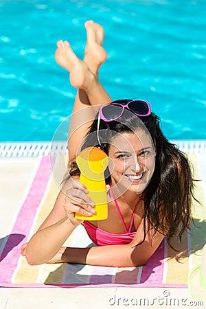 Woman summer sunbathing and suntan lotion