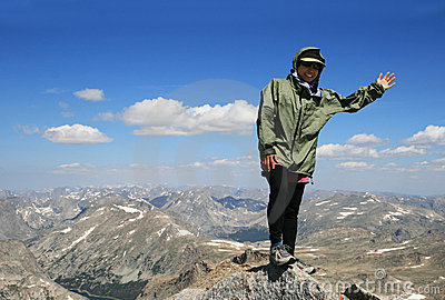 Woman on summit of peak