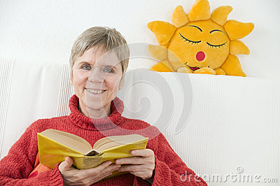 Woman with sun and book front