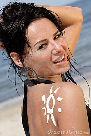 Woman with sun-shaped sun cream