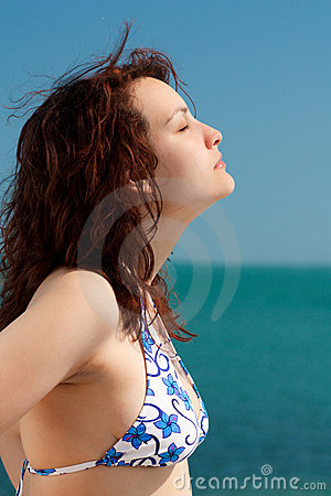 Woman Sunbathing on a Beach