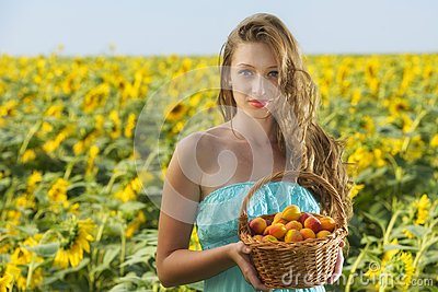 Woman in sunflower chain with a basket of fruit