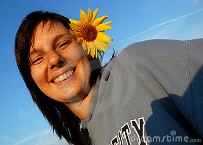 Woman with sunflower in hair