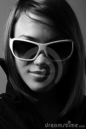 Woman in sunglasses. Fashion bw portrait.