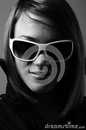 Woman in sunglasses. Fashion bw portrait.