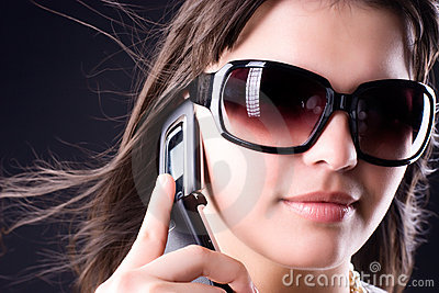 Woman in sunglasses with mobile phone