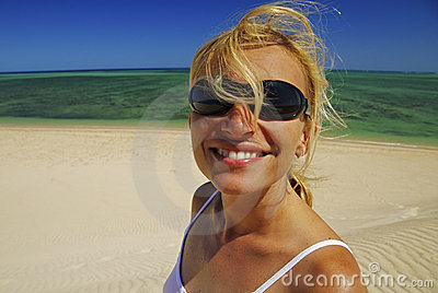 Woman With Sunglasses Relaxing On The Beach