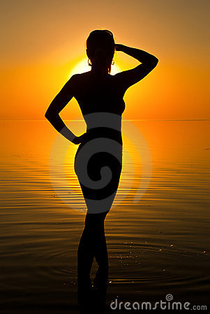Woman in sunrise light