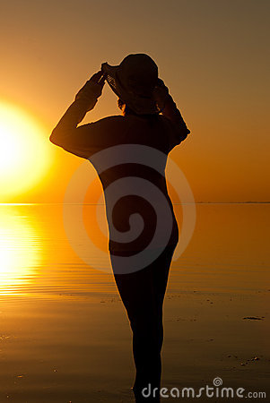 Woman in sunrise light