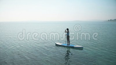 Woman on SUP. Young Female Stand Up Paddling. stock video